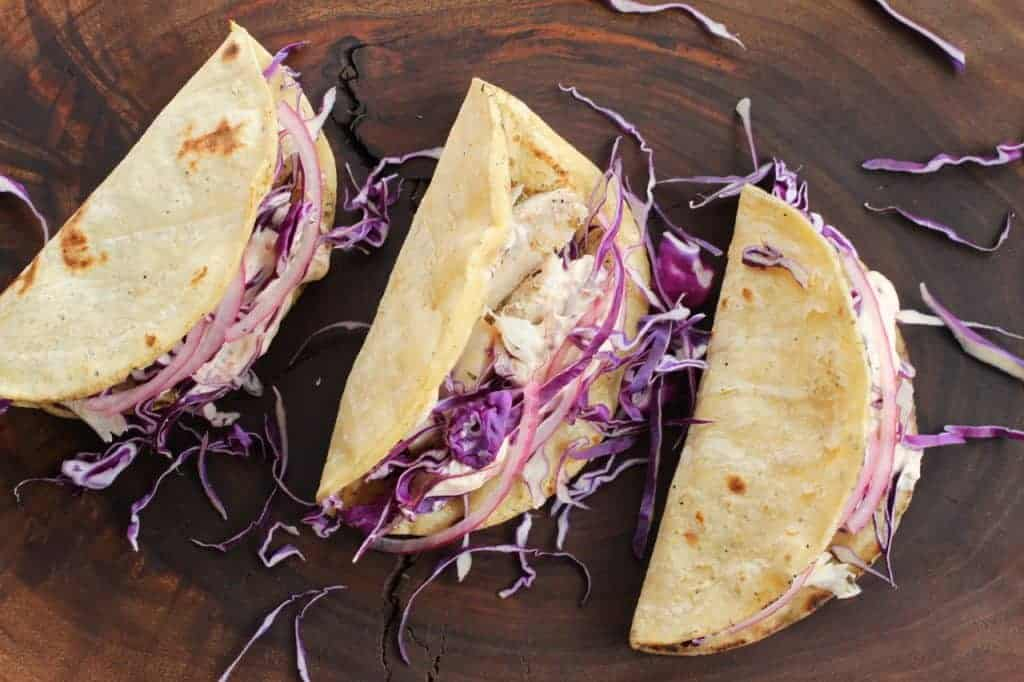 Fish Tacos, yogurt chipotle crema, pickled onion = Yum! www.LiveBest.info