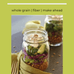 jar of layered spelt salad with cooked spelt, celery , red cabbage, broccoli, cucumber and a creamy herb dressing