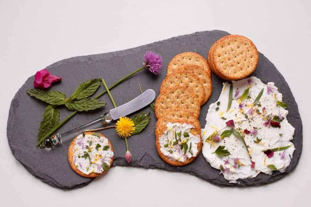 Herb and flowers on yogurt
