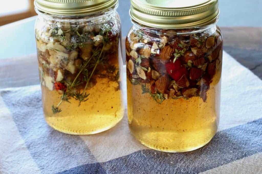 2 jars of honey infused with nuts and thyme