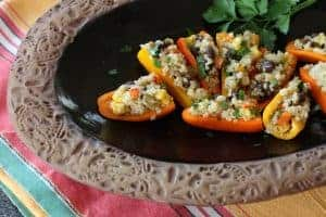 Black Bean Quinoa Salad | This high protein, high fiber vegetarian salad is filled with delicious real food. It is easy to make and keeps well. In this recipe I stuffed mini peppers for an appetizer! www.LiveBest.info