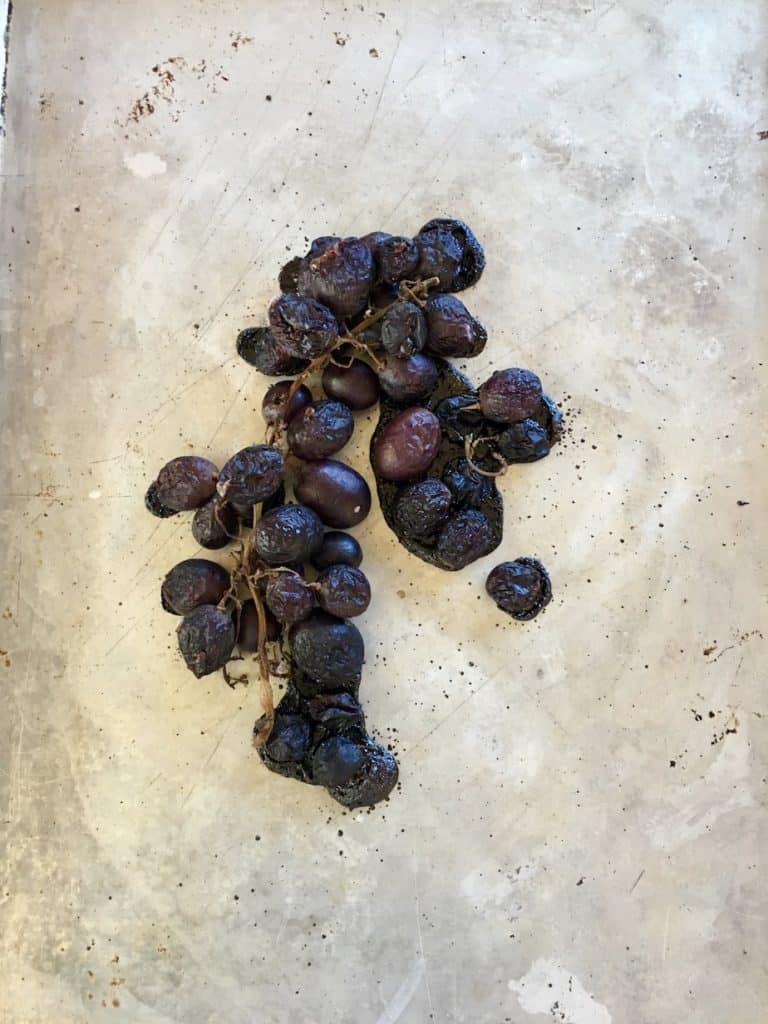 roasted grapes on baking sheet