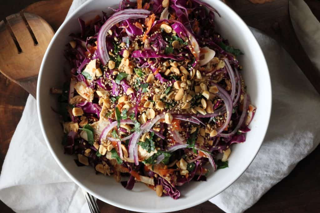 bowl of asian chicken salad with red cabbage and carrots