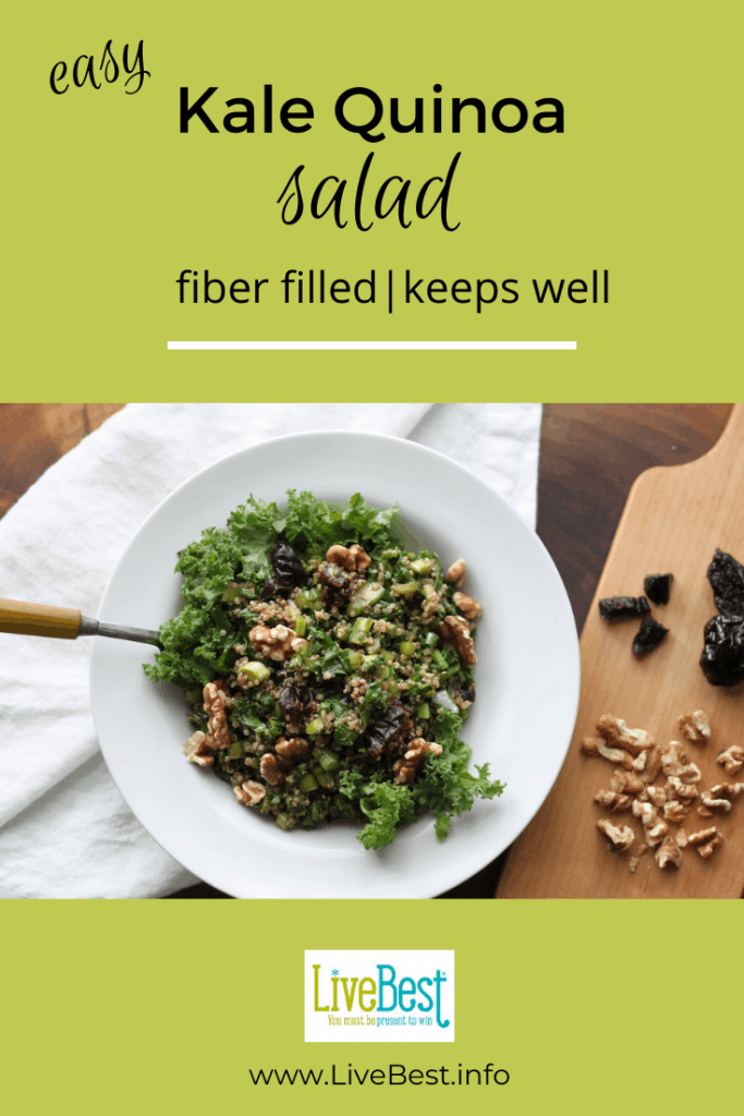 bowl of kale and quinoa salad with prunes and walnuts